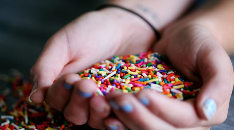 Person Holding Full of Sprinkles by Sharon McCutcheon