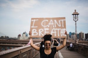 Woman Holding a Sign in Protest